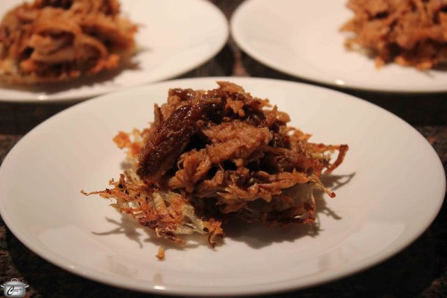 There are loads of topping possibilities with latkes; while it's definitely not kosher, pulled pork is really tasty on top!