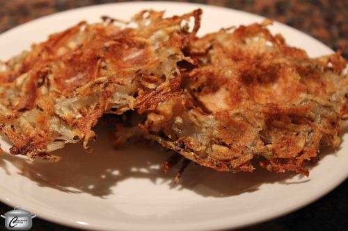 Cooking the soaked, grated potatoes in a lightly greased waffle iron makes for a healthier yet still flavourful latke.