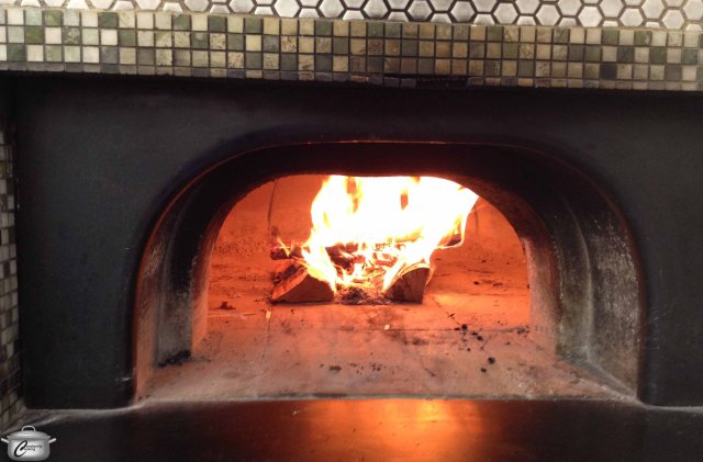 The Back Lane Cafe's wood ovens are used for many purposes; they add flair to the menu, and heat to the kitchen.