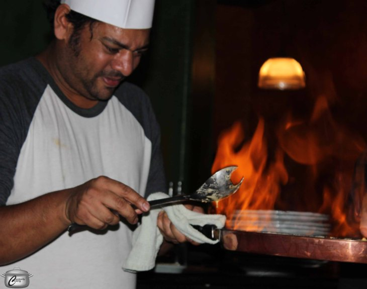 Arup Jana helped Pat Garland prepare crepes Suzette in a delightful bit of culinary showmanship.