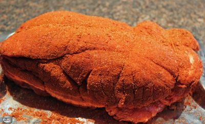 Covering the meat in a dry spice rub adds loads of flavour before roasting and smoking it.