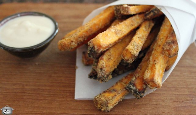 Coating evenly-sized pieces of sweet potato with cornstarch before baking is the secret to crispy fries.
