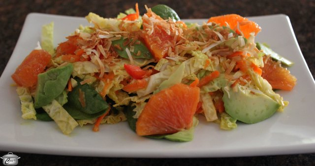 Citrus and curry give this salad a lively tang; the coconut topping makes it unforgettable.