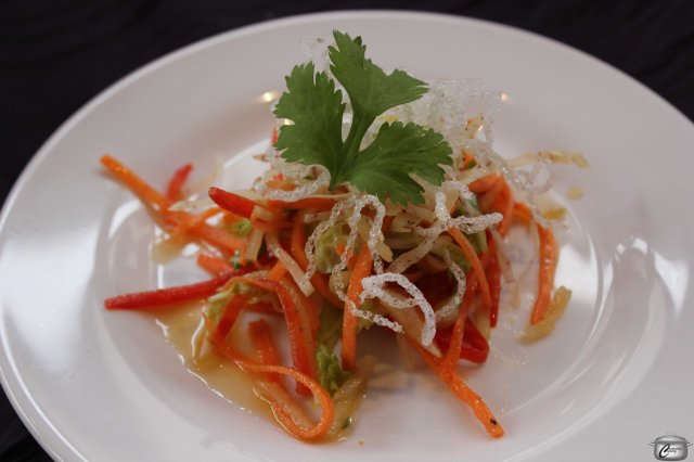 Crispy aromatic green papaya salad with fried vermicelli and a miso ginger vinaigrette. Absolutely delectable.