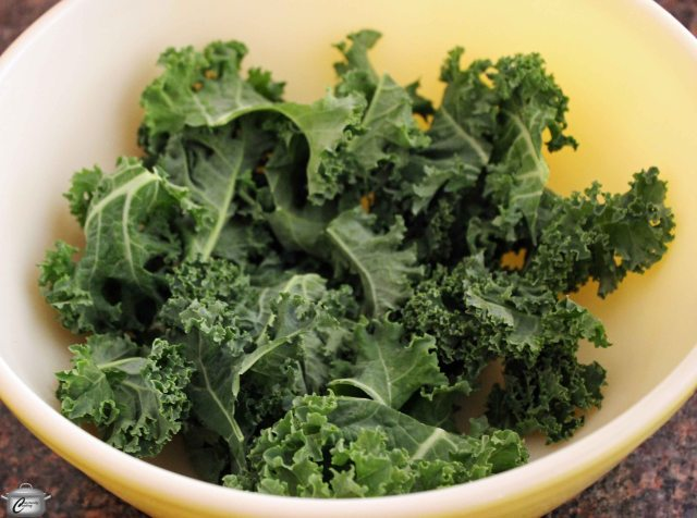 Make sure the kale pieces are very dry before you drizzle oil on them, otherwise they won't crisp up as well.