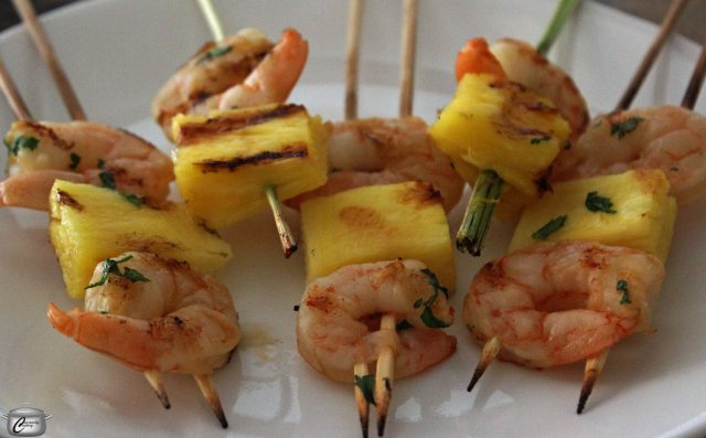Smaller skewers of pineapple and shrimp are quick to grill and easy to eat at a backyard cocktail party.