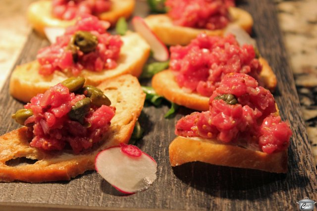 Steak tartare with minced ribeye, Dijon, shallot, chive and lemon.