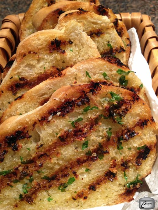 Grilling makes garlic bread that's way more flavourful than oven-baked.