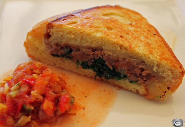 """Grilled cheese """"lambwich"""" with brioche, aged white cheddar, braised lamb shank, arugula, fiery """"ratatouille"""" relish- arugular and relish ingredients provided by Acorn Creek Farm"""