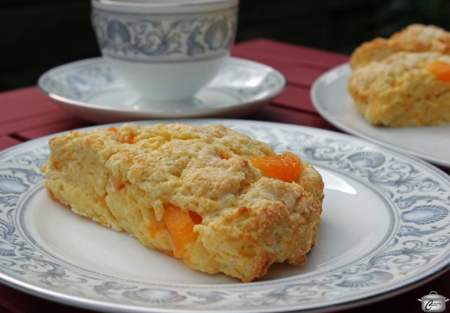 The combination of apricots and cream infused with cardamom seeds gives these scones a unique, delicious flavour.