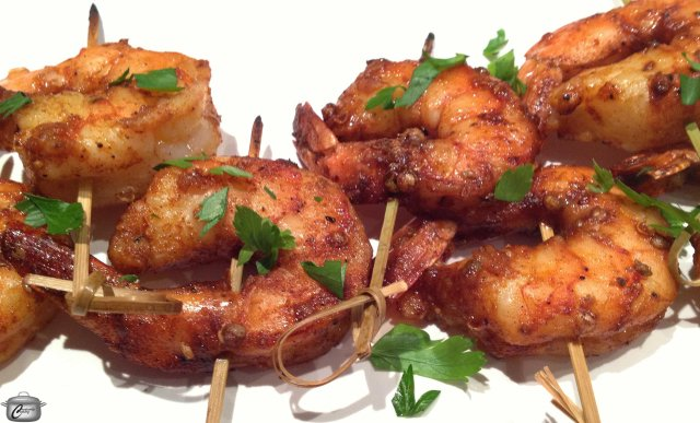 Grilling the skewered shrimp on a cedar plank gives them a gently, smokey flavour that is enhanced by the marinade.