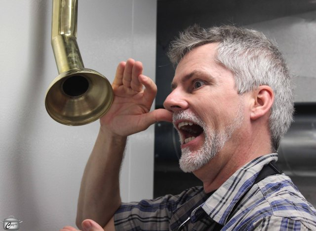 """Dave """"The Big Banzini"""" Scharf having a little fun with his low-tech intercom system (a brass speaking tube)"""