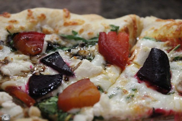 The Flying Banzini's Steve McQueen pizza, with roasted beets, fig tapenade, beet greens, fresh basil, balsamic reduction, chèvre and mozzarella.