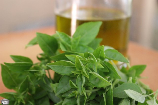 Freezing chopped basil in oil gives you a versatile mixture that can be used in many ways, including making batches of midwinter pesto!