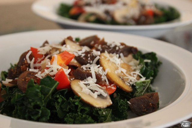 Barely-wilted kale and sauteed vegetables make a great salad; topping it with figs and parmesan makes the flavour pop.
