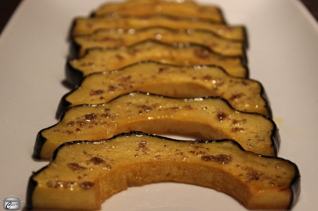 Sliced acorn squash looks prettier on the plate than a blob of mashed squash.  Cardamom and maple syrup give it an irresistible flavour punch.