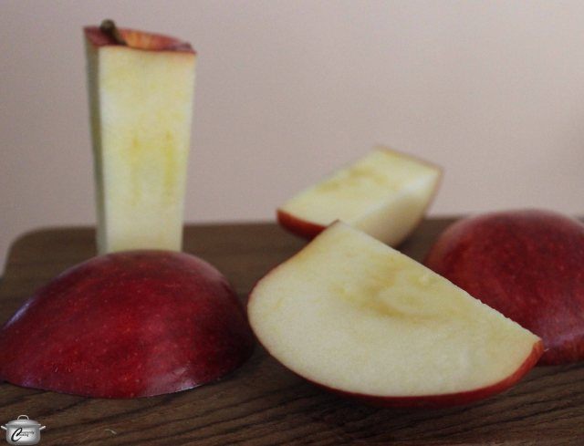 Cutting the apple off the core before slicing is the fastest way to accomplish this task.