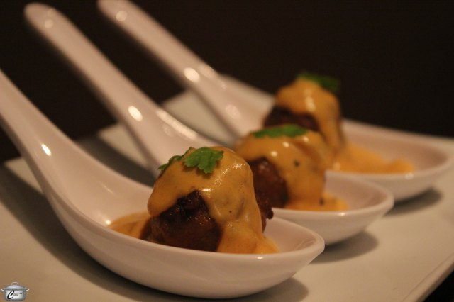 Meatballs topped with a flavourful cream sauce make for an attractive and delicious Russian-inspired appetizer.
