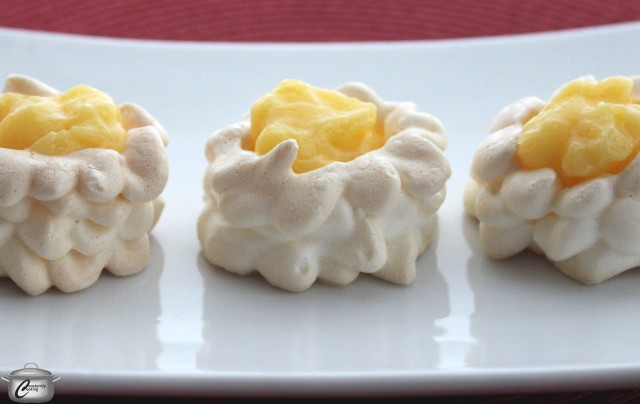 Tiny meringue nests are the perfect vessel for tangy, delicious lemon curd.