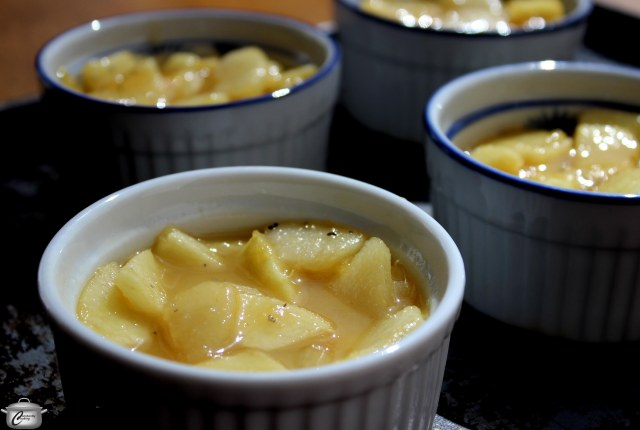 Cooking the fruit in the caramel sauce ensures that it won't shrink down as much during baking.