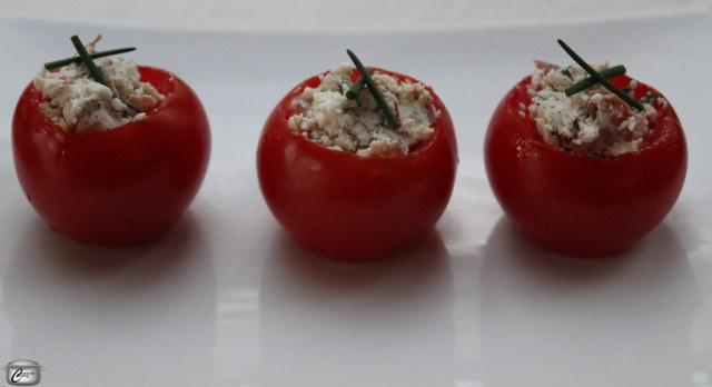 Little tomatoes stuffed with chevre, chives and crispy prosciutto make a tasty appetizer or salad alternative.