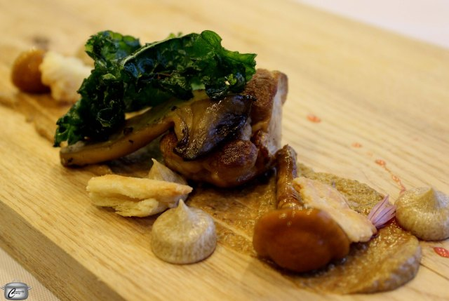 Le Coprin mushrooms accompanied by a puree of reconstituted dry mushrooms, blue cheese and walnuts along with sauted, fire-smoked mushrooms glazed with raspberry vinaigrette and topped with kale chips.
