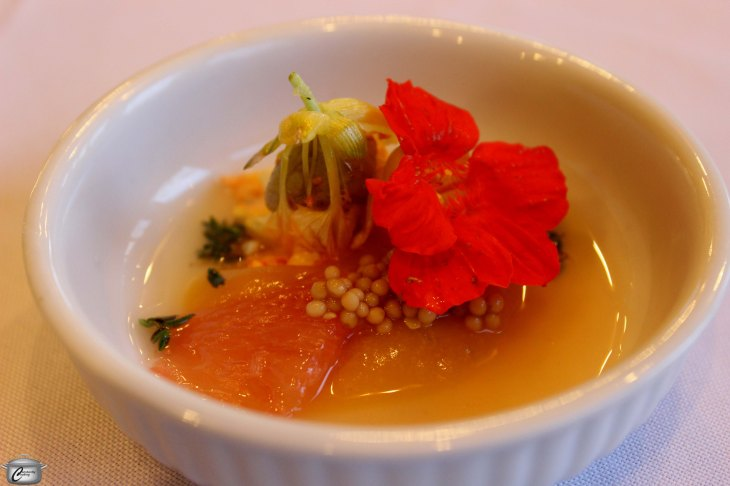Nasturtium flower and nasturtium bud stuffed with thyme scented cashew butter along with grapefruit, pickled mustard seeds, verjus, apricot and ginger puree.
