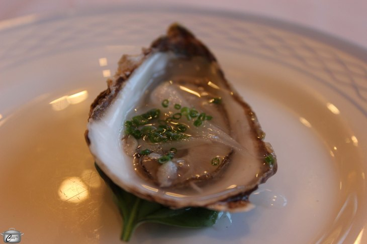 """""""Lucky Lime"""" Malpeque oyster with pickled ramp."""