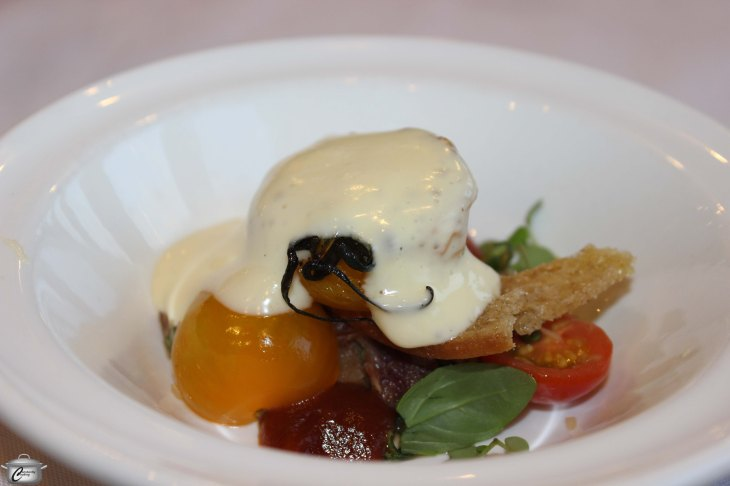 Char-grilled tomatoes on cherry tomatoes and ham hock salad with Nat's bread crostini, smoked tomato ketchup and aerated bacon hollandaise.