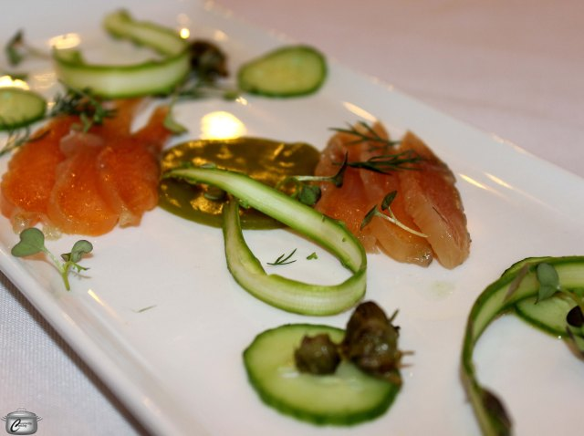 "Arctic ""char""-cuterie featuring leek gelee with honey, gravlax-style cured char, pickled dandelion buds, fresh asparagus ribbons and cucumber."