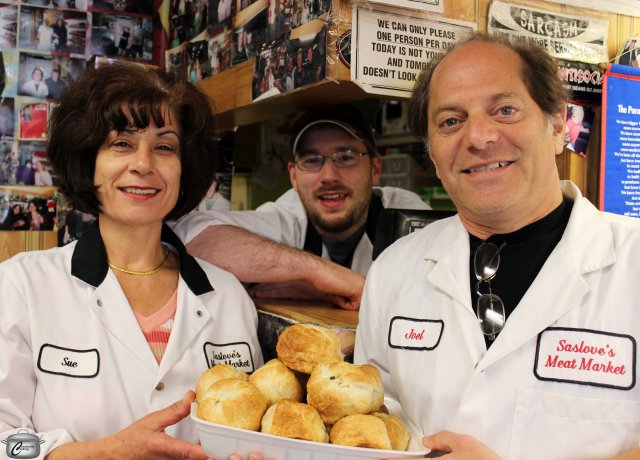 Longtime Saslove's employee Sue Saikaley, butcher Connor Wells and owner Joel Diener with a tray of the shop's fabulous knishes.