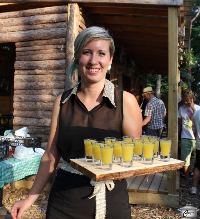 Volunteer servers like Julie Ribi, shown here with shots of tasty yellow tomato gazpacho, were both cheerful and professional throughout the entire evening, adding much to the fun atmosphere of FLUX.