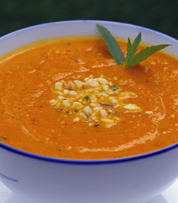 carrot soup flavoured with ras el hanout and garnished with mint and dukkah