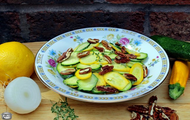 Tender young zucchini makes a delicious salad when dressed up with zippy lemon-thyme-sweet onion vinaigrette and pecans.