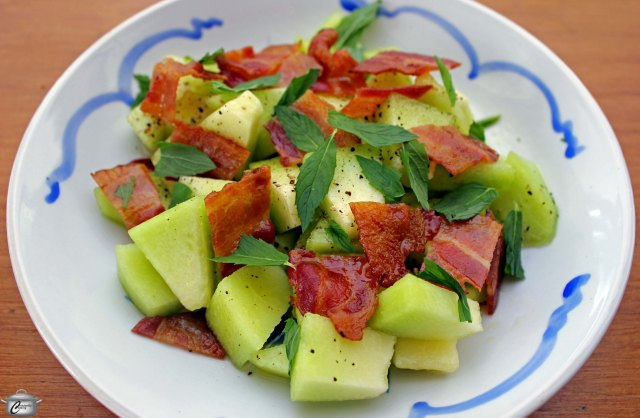 Cool, juicy melon and warm, crisp bacon are a perfect pairing. The lemony vinaigrette and mint complement both of the salad's main components.