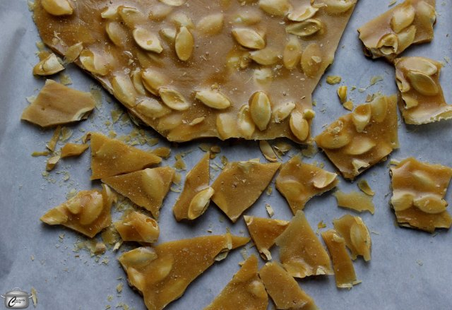 Wait until the brittle has cooled completely before breaking it into bite-sized pieces with your fingers.