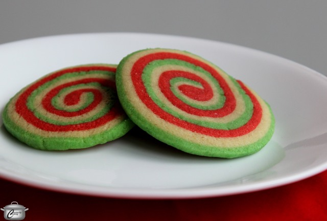 Vibrant coloured dough flavoured with a hint of peppermint makes these roll-slice-bake pinwheel cookies tasty and attractive.