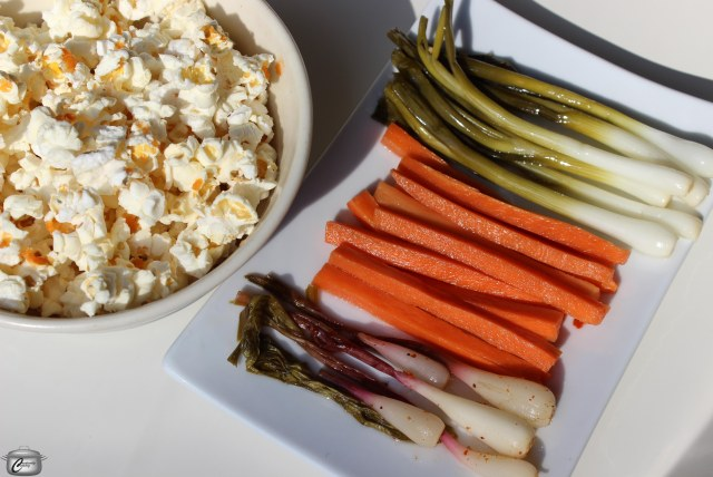 Brighten up your cocktail party offerings with a plate of pickled local vegetables and some popcorn sprinkled with salt and hot sauce.