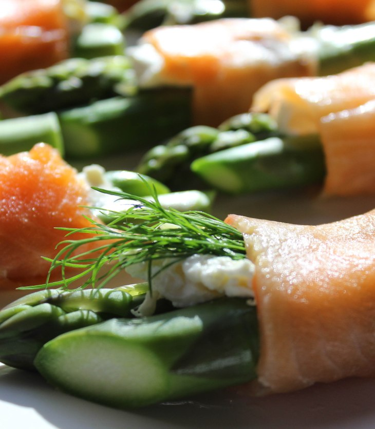 Lightly cooked asparagus wrapped in smoked salmon is an easy yet impressive appetizer
