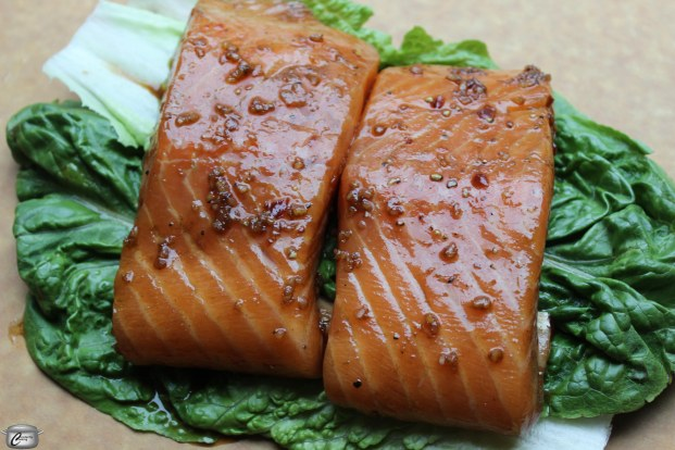 A bed of lettuce leaves insulates the salmon perfectly as it is on the grill.