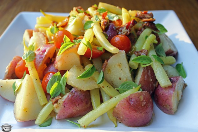 Fresh from the garden yellow beans, red skinned potatoes and cherry tomatoes are fabulous topped with a bacon-studded dressing.
