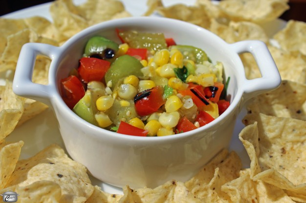 Grilling fresh corn, tomatillos and red pepper before making them into salsa adds a ton of extra flavour.