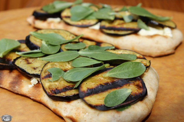 Grilled flatbread topped with cream cheese, garlicky grilled eggplant and tasty greens such as purslane makes for a delicious lunch or a fun appetizer.