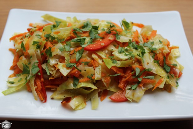 This made-in-reverse coleslaw features a zippy dressing which is heated to just barely wilt the vegetables. It's delicious!