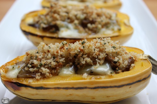 Delicata squash stuffed with a combination of shallots, sunchokes and mushrooms, then topped with cheese and savoury breadcrumbs.