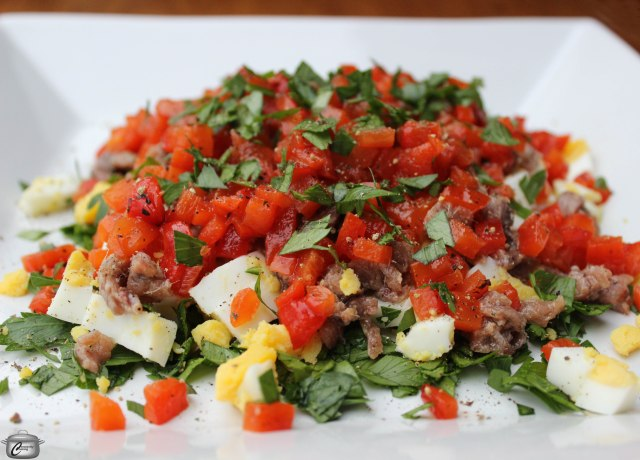 This dish is an impressive, flavourful appetizer which includes roasted red pepper, hardboiled eggs, anchovies and parsley, dressed up with a garlicky vinaigrette.