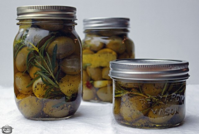 Dress up ho-hum green olives with herbs, garlic, lemon and olive oil to make a delicious treat that's two gifts in one!