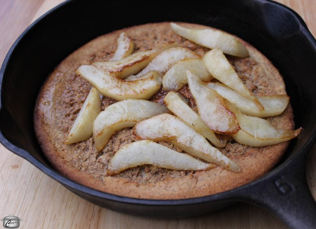 Pancakes are easier than ever when baked in a hot cast iron skillet. Top with caramelized pears and you'll be a hero!