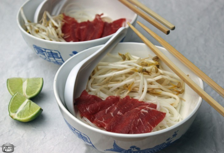 Thinly sliced raw beef will cook to medium rare almost instantly when you pour the hot, fragrant broth over top.