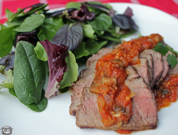 Perfectly seared baseball cut top sirloin steak is finished in the oven and topped with a pizza-inspired sauce for a fresh new presentation.